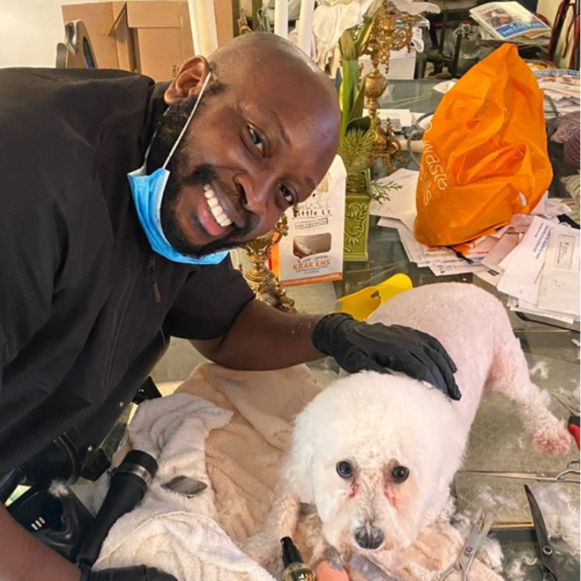 Brian Taylor of Harlem Doggie Day Spa with Romeo